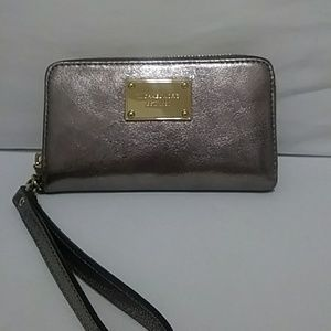 Michael Kors silver/gold wallet wristlet.